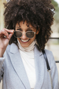 Portrait of happy woman wearing sunglasses - EBSF02183