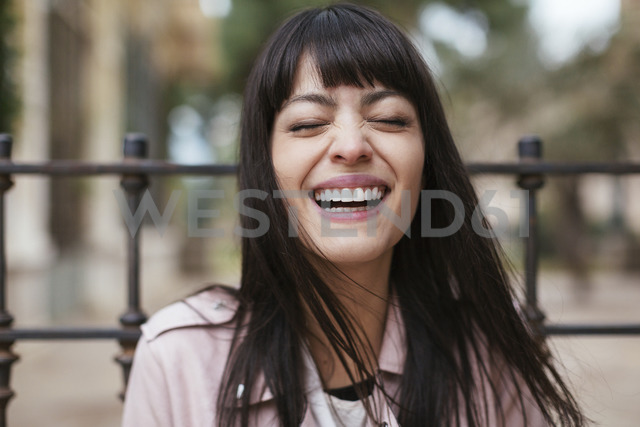 Portrait of laughing young woman outdoors - EBSF02186