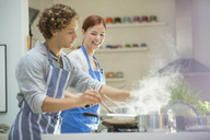 Couple cooking in kitchen - CAIF01916