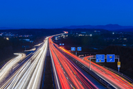 Germany, Baden-Wuerttemberg, Autobahn A8 near Wendlingen in the evening, light trails - WDF04477