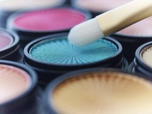 Close up of makeup brush with eyeshadows - CAIF02076