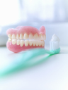 Close up of dentures and toothbrush - CAIF02079