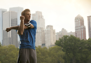 Runner stretching in urban park - CAIF02097