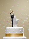 Confetti falling on wedding cake - CAIF02118