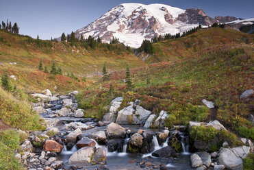 Mountain overlooking rocky creek and rural landscape - CAIF02142