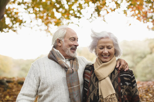 Older couple walking together in park - CAIF02331