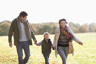 Family walking together outdoors - CAIF02337