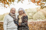 Older couple walking in park - CAIF02385