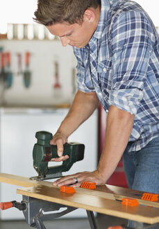 Man working in workshop - CAIF02421