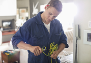 Electrician cutting wires in home - CAIF02424