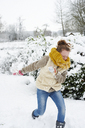 Girl playing in snow - CAIF02445