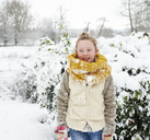 Girl smiling in snow - CAIF02454