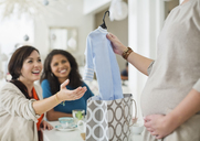 Pregnant woman having baby shower - CAIF02463