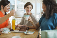 Women having coffee and cake together - CAIF02469