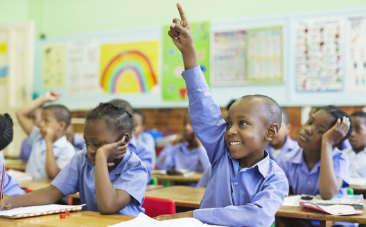 Student raising hand in class - CAIF02502