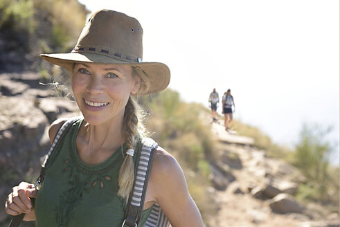 Portrait of smiling woman on a hiking trip - ECPF00222