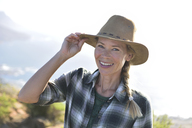 Portrait of smiling woman on a hiking trip - ECPF00225