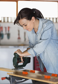 Woman working in workshop - CAIF02543