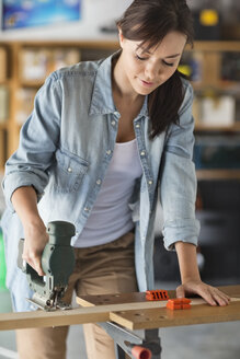 Woman working in workshop - CAIF02546