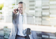 Businessman talking on cell phone - CAIF02600