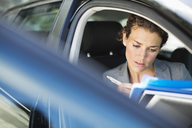 Businesswoman working in car - CAIF02645