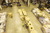 Workers talking in warehouse - CAIF02777