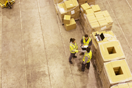 Workers talking in warehouse - CAIF02825