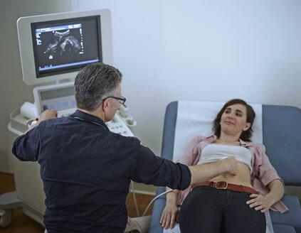 Woman in hospital getting sonogram - CVF00190