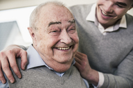 Portrait of happy senior man with young man - UUF12871