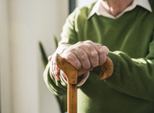 Close-up of senior man leaning on cane - UUF12895