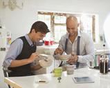 Businessmen having breakfast together - CAIF03137