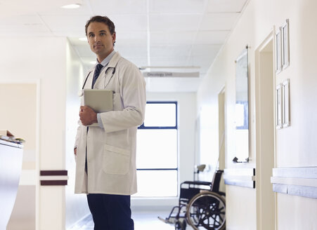 Doctor standing in hospital hallway - CAIF03260