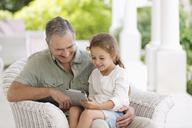 Older man and granddaughter using tablet computer - CAIF03386