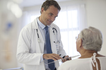 Doctor talking to older patient in hospital - CAIF03431