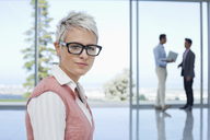 Businesswoman standing in office - CAIF03500