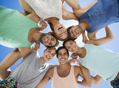 Low angle portrait of happy friends in huddle - CAIF03518