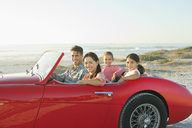Family in convertible at beach - CAIF03614