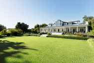 Luxury house facing sunny lawn - CAIF03677