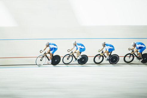 Cyclists racing around velodrome - CAIF03719