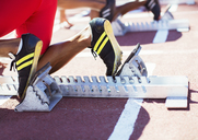 Runner's feet in starting blocks on track - CAIF03737
