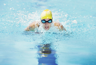 Swimmer wearing goggles in pool - CAIF03743