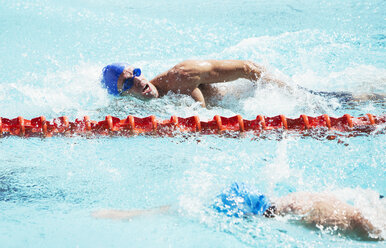 Swimmers racing in pool - CAIF03758