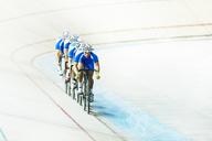 Track cycling team riding in velodrome - CAIF03761