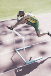 Runner clearing hurdle on track - CAIF03767