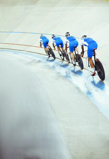 Track cycling team riding in velodrome - CAIF03779