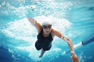 Swimmer racing in pool - CAIF03785