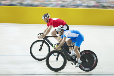 Track cyclists racing in velodrome - CAIF03806