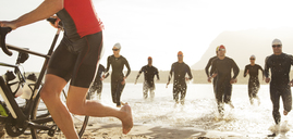 Triathletes emerging from water - CAIF03822