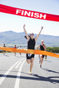 Runner crossing race finish line - CAIF03840