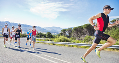 Runners in race on rural road - CAIF03852